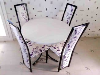 Chairs with backs to the kitchen