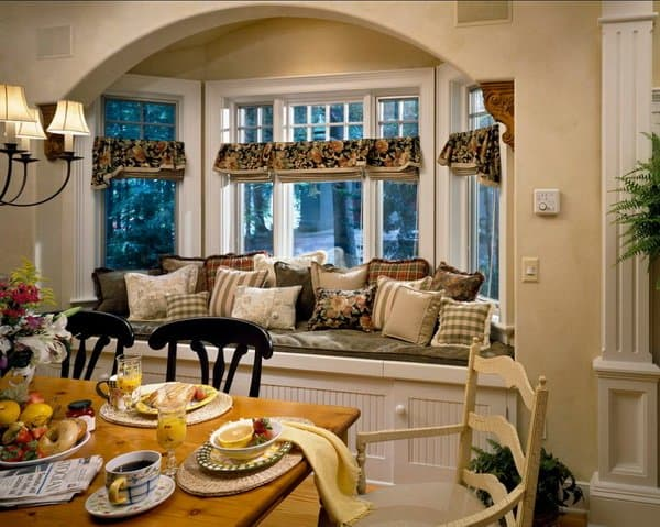 dining room and sitting area with bay window