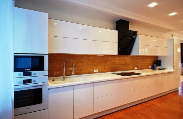 modern kitchen has beautiful cabinets with straight lines